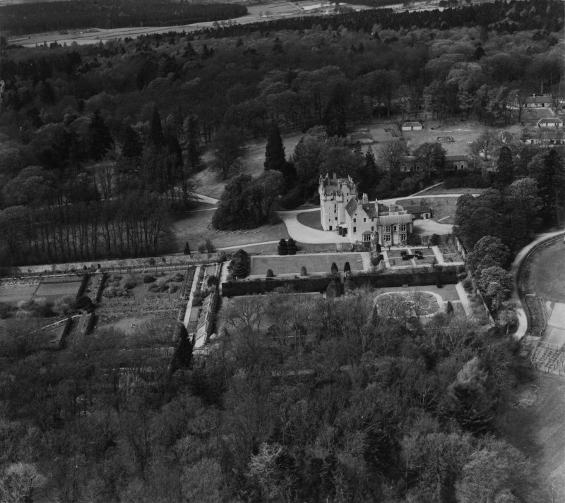 Crathes Castle and Garden, Banchory.  Oblique aerial photograph taken facing west.  This image has been produced from a print.