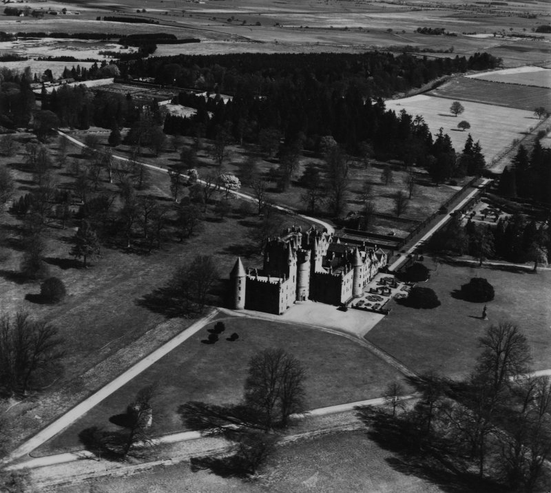 Glamis Castle and Estate.  Oblique aerial photograph taken facing north-east.  This image has been produced from a print.