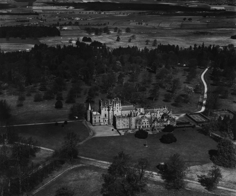 Glamis Castle and Estate.  Oblique aerial photograph taken facing north.  This image has been produced from a print.