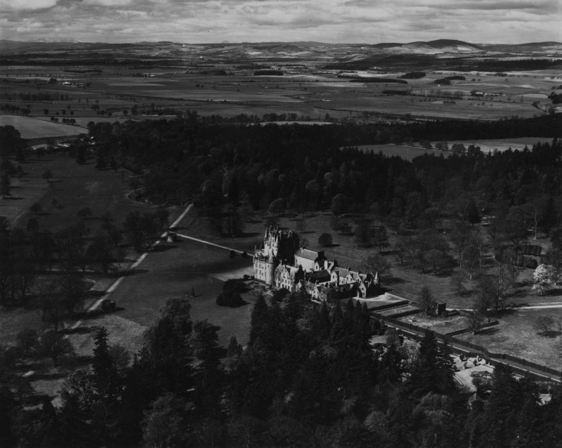 Glamis Castle and Estate.  Oblique aerial photograph taken facing west.  This image has been produced from a print.