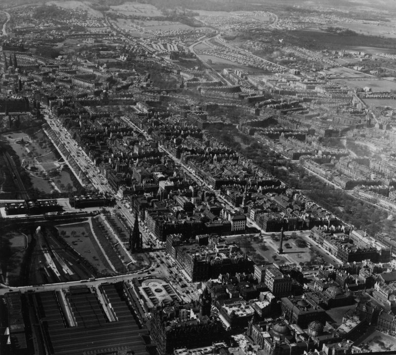Edinburgh, general view, showing Princes Street and Queen Street Gardens.  Oblique aerial photograph taken facing west.  This image has been produced from a print.