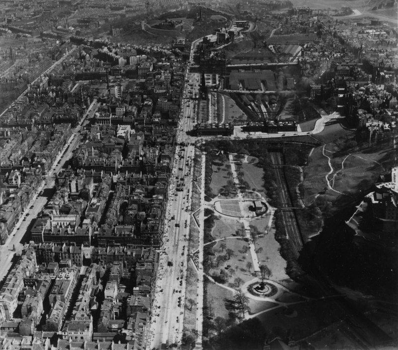Edinburgh, general view, showing Princes Street and Waverley Station.  Oblique aerial photograph taken facing east.  This image has been produced from a print.