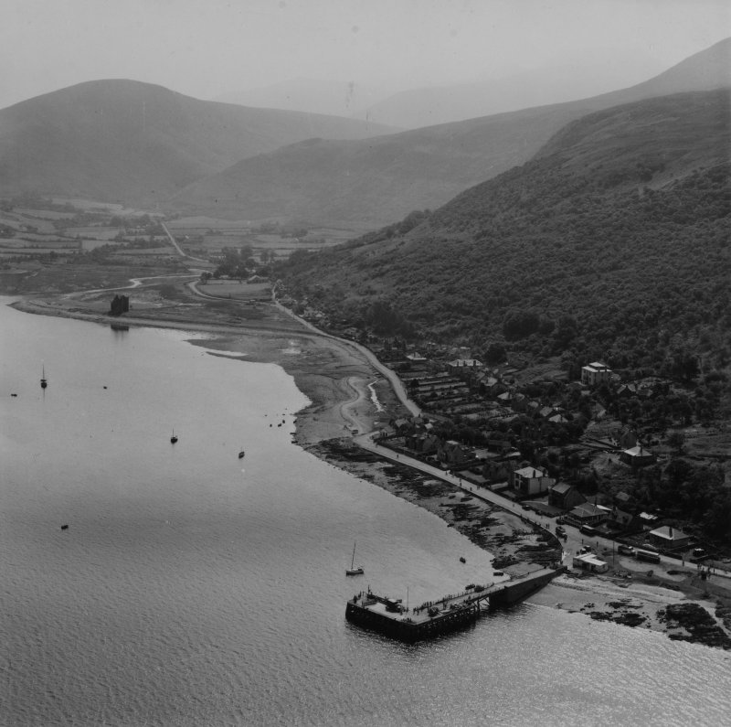 Lochranza, general view, showing Coillemore Point and Lochranza Castle, Isle of Arran.  Oblique aerial photograph taken facing south-east.  This image has been produced from a print.