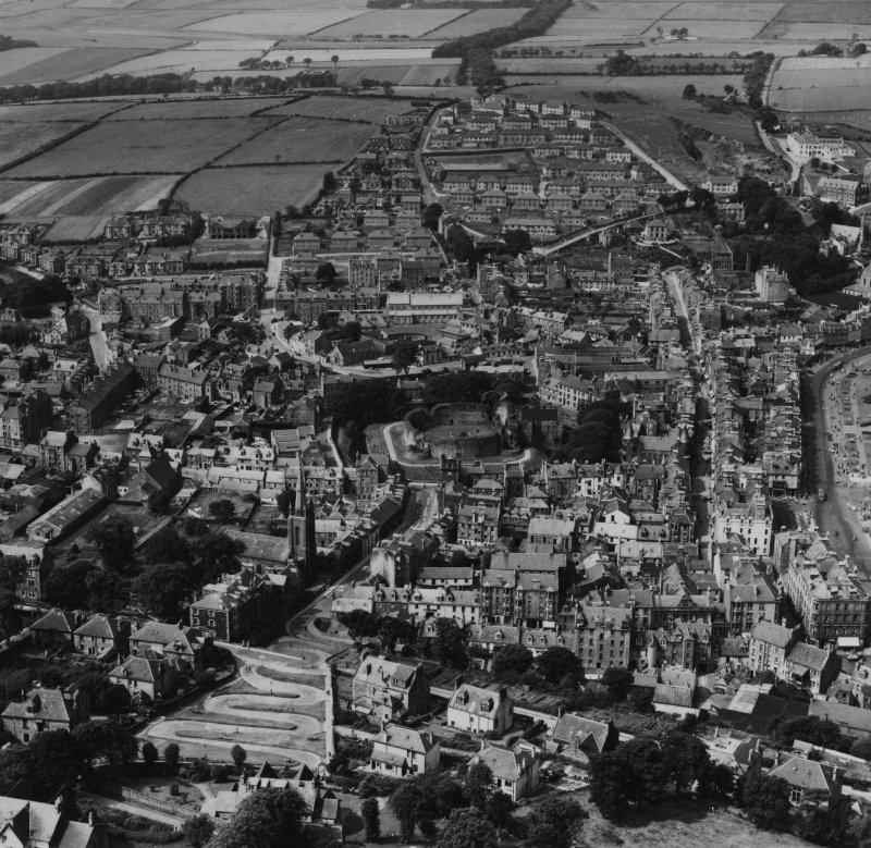 Rothesay, general view, showing Rothesay Castle and Serpentine Road, Isle of Bute.  Oblique aerial photograph taken facing west.  This image has been produced from a print.