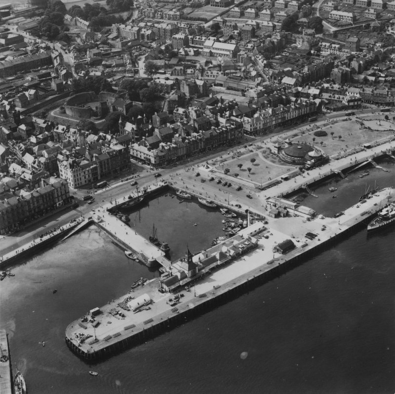 Rothesay, general view, showing Rothesay Harbour and Castle, Isle of Bute.  Oblique aerial photograph taken facing south-west.  This image has been produced from a print.