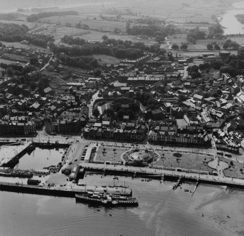 Rothesay, general view, showing Winter Gardens and Rothesay Castle, Isle of Bute.  Oblique aerial photograph taken facing south.  This image has been produced from a print.