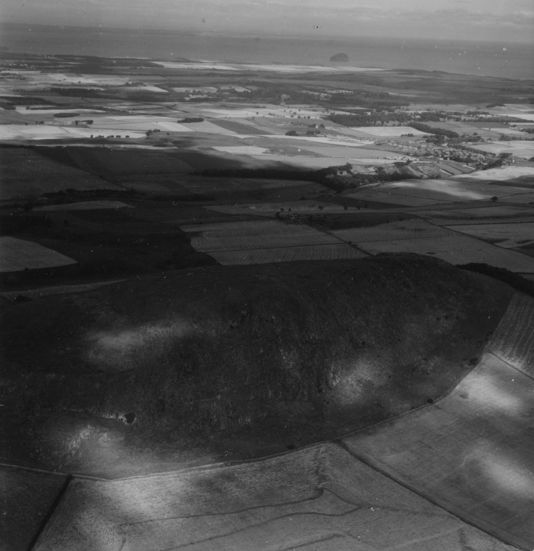 Traprain Law.  Oblique aerial photograph taken facing north.  This image has been produced from a print.