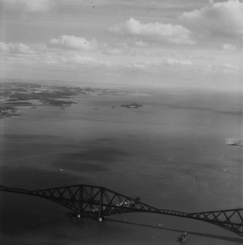 Forth Rail Bridge and Inchcolm, Firth of Forth.  Oblique aerial photograph taken facing east.  This image has been produced from a print.