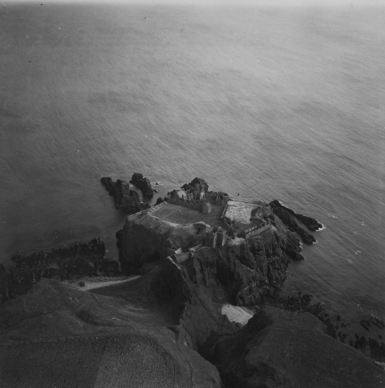 Dunnottar Castle.  Oblique aerial photograph taken facing east.  This image has been produced from a print.
