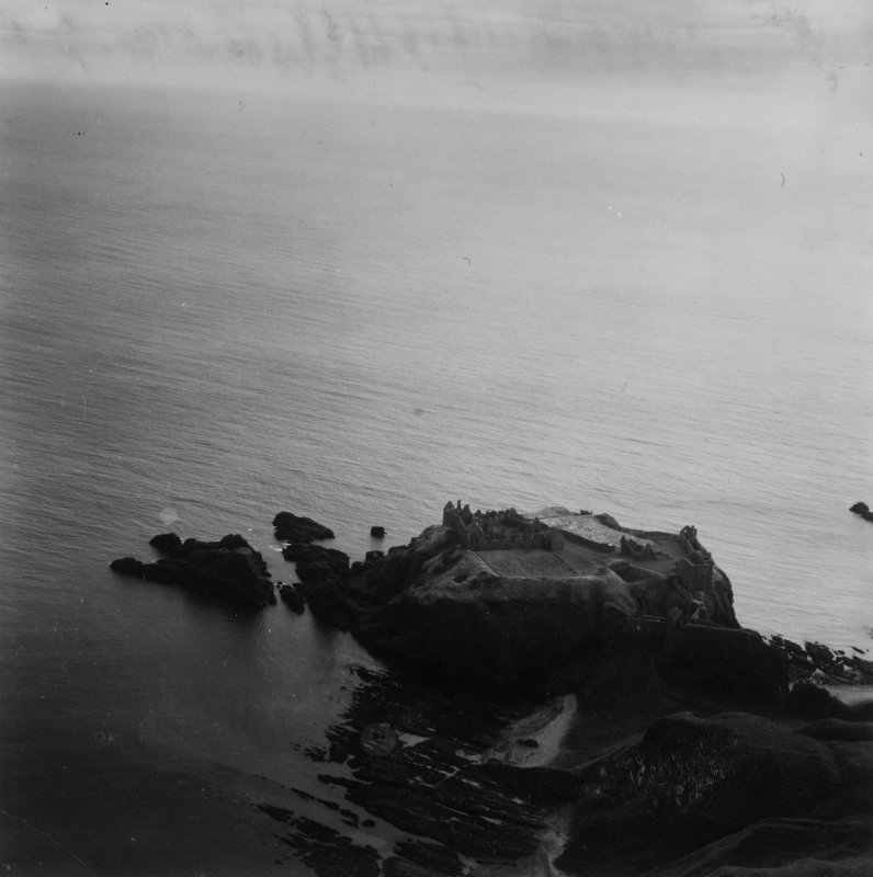 Dunnottar Castle.  Oblique aerial photograph taken facing south-east.  This image has been produced from a print.