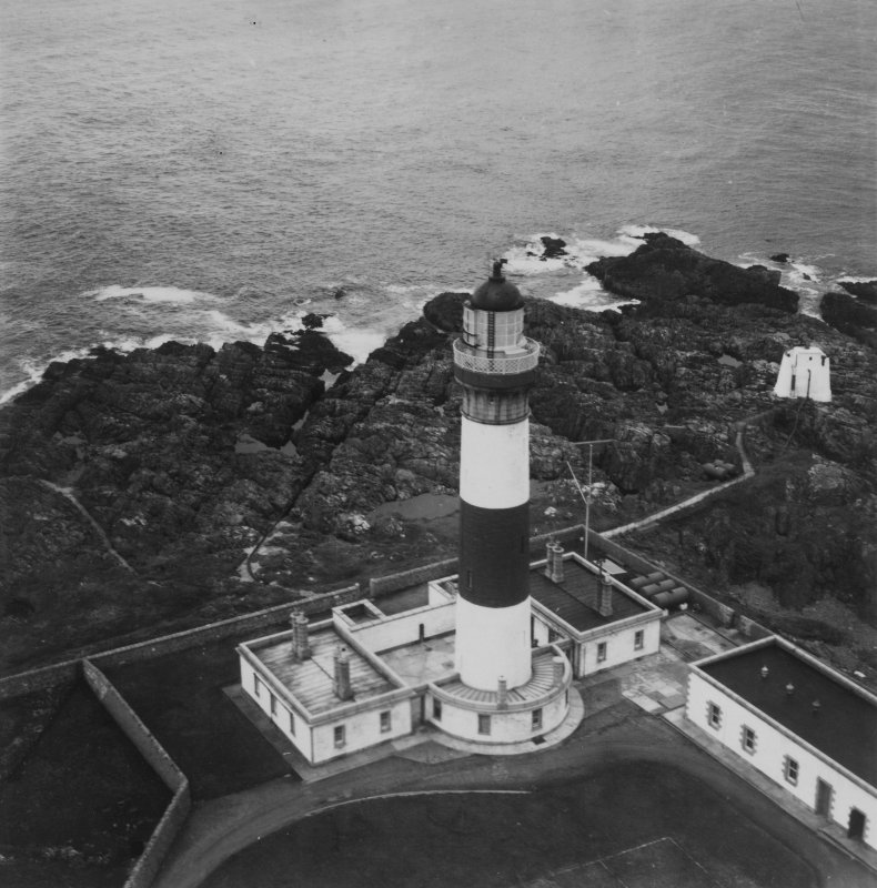 Buchan Ness Lighthouse, Boddam.  Oblique aerial photograph taken facing east.  This image has been produced from a print.