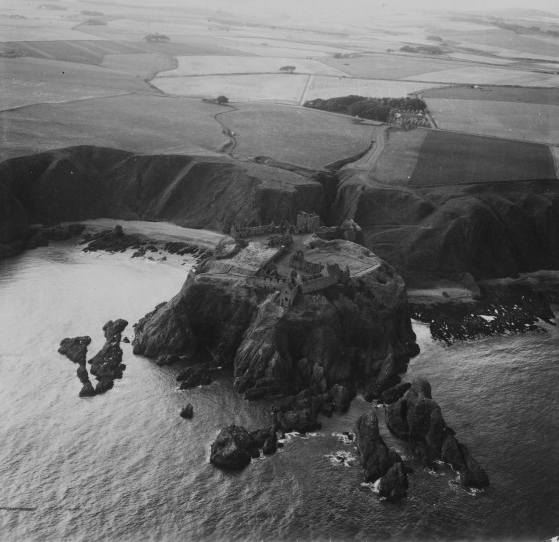 Dunnottar Castle.  Oblique aerial photograph taken facing west.  This image has been produced from a print.
