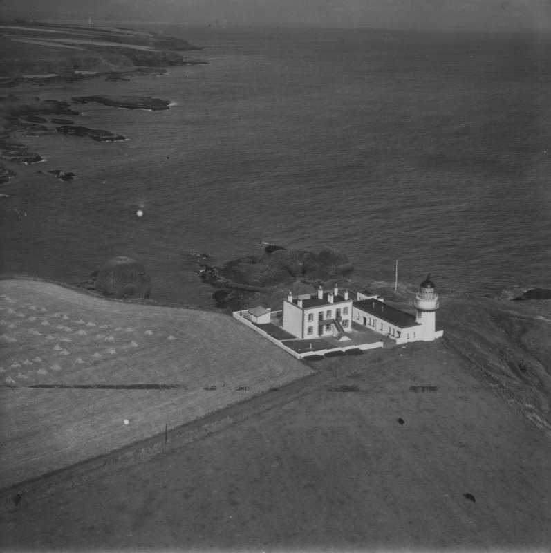 Todhead Lighthouse, Todhead Point.  Oblique aerial photograph taken facing north-east.  This image has been produced from a print.