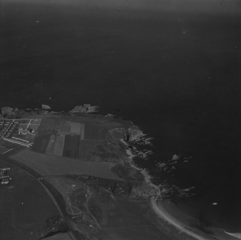 Portknockie, general view, showing Scar Nose and Toshie's Long Craigs.  Oblique aerial photograph taken facing north.  This image has been produced from a print.