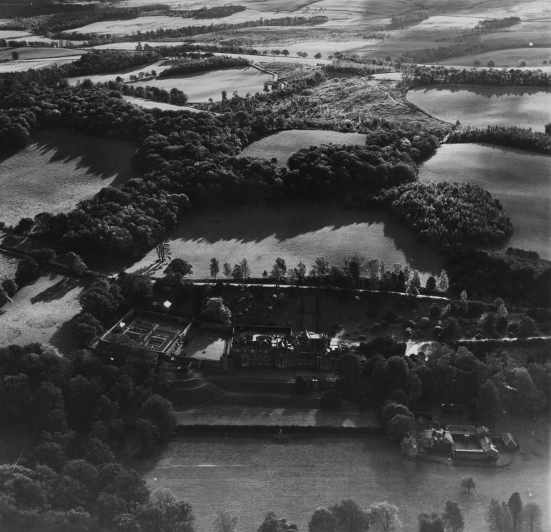 Abbotsford House and Grounds, Melrose.  Oblique aerial photograph taken facing south-east.  This image has been produced from a print.
