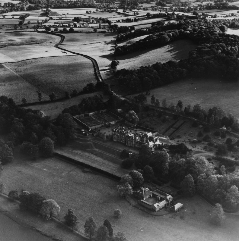 Abbotsford House and Grounds, Melrose.  Oblique aerial photograph taken facing east.  This image has been produced from a print.