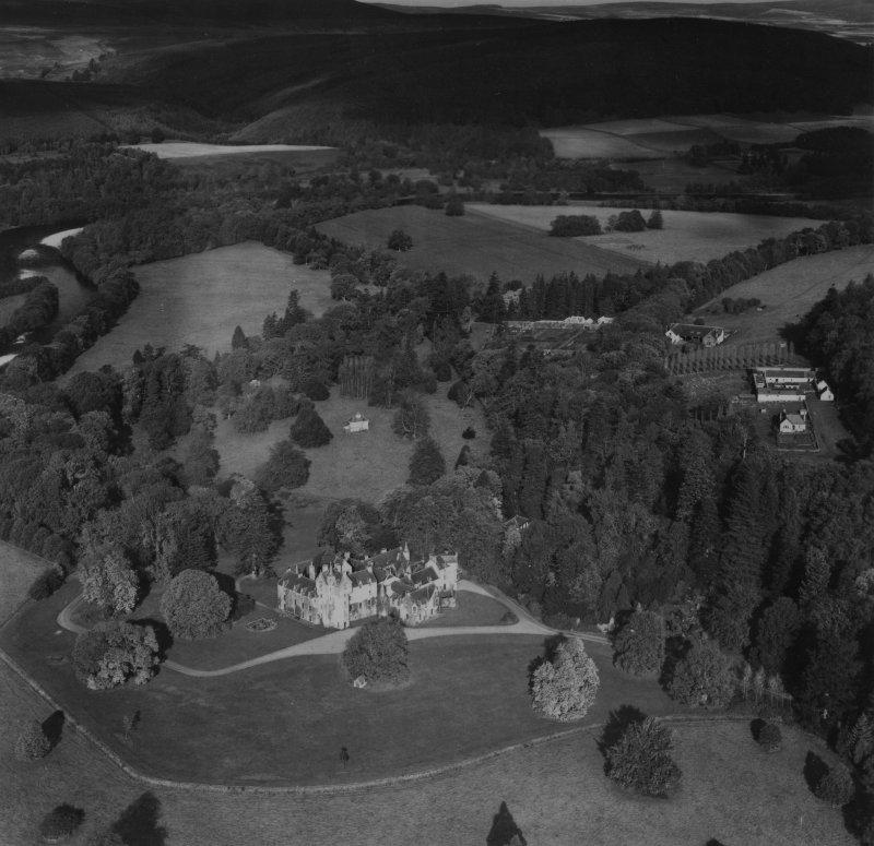 Ballindalloch Castle and Stables.  Oblique aerial photograph taken facing north.  This image has been produced from a print.