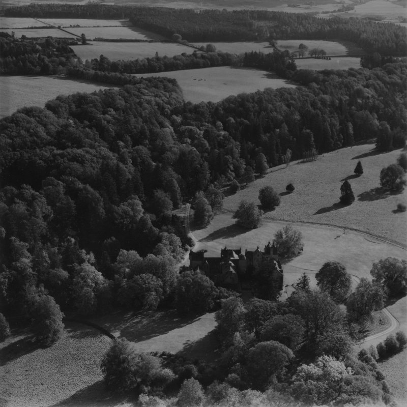 Ballindalloch Castle.  Oblique aerial photograph taken facing south-east.  This image has been produced from a print.