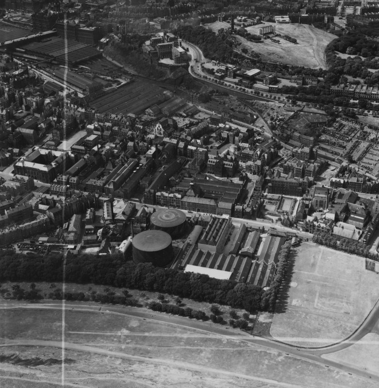 Edinburgh, general view, showing William Younger and Co. Ltd. Holyrood Brewery and Calton Hill.  Oblique aerial photograph taken facing north-west.  This image has been produced from a crop marked print.