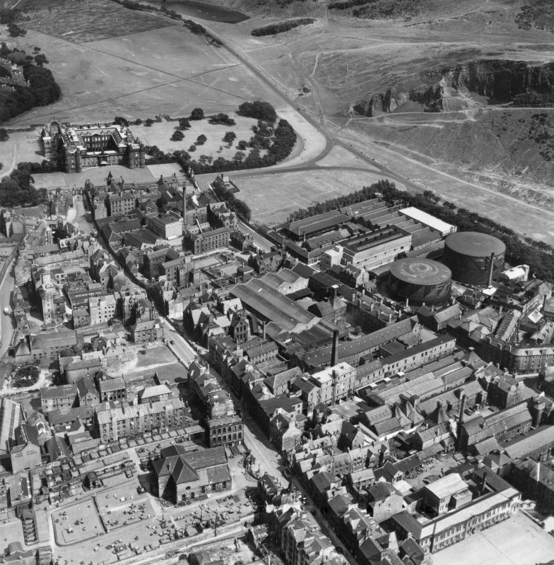 Edinburgh, general view, showing William Younger and Co. Ltd. Holyrood Brewery and Palace of Holyroodhouse.  Oblique aerial photograph taken facing east.  This image has been produced from a crop marked print.