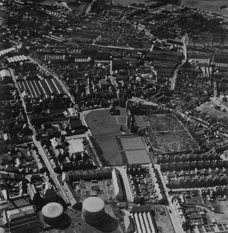 Arbroath, general view, showing Arbroath Abbey and Cairnie Street.  Oblique aerial photograph taken facing west.  This image has been produced from a print.
