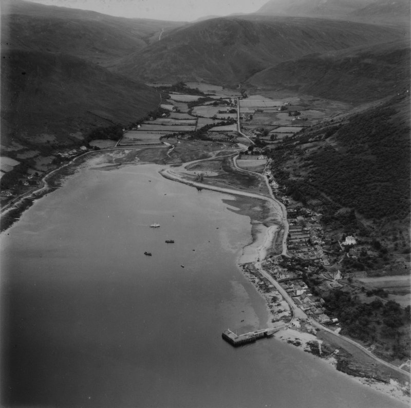 Lochranza, general view, showing Lochranza Castle and Torr Nead an Eoin, Isle of Arran.  Oblique aerial photograph taken facing south-east.  This image has been produced from a print.
