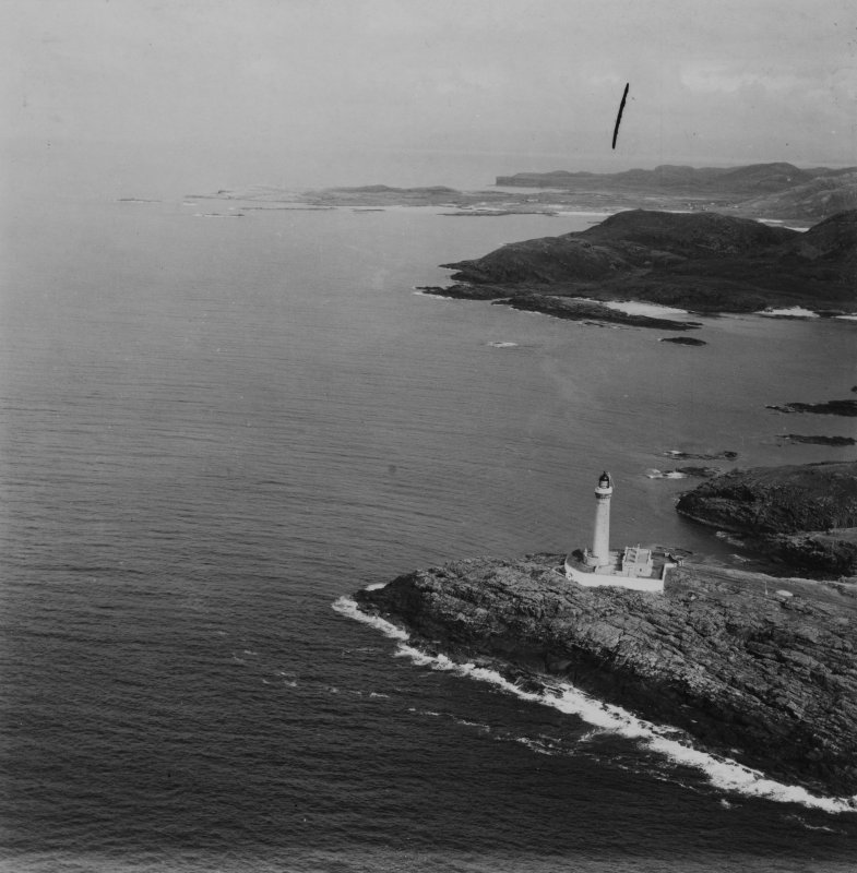 Ardnamurchan Lighthouse and Sanna Bay.  Oblique aerial photograph taken facing north-east.  This image has been produced from a damaged print.