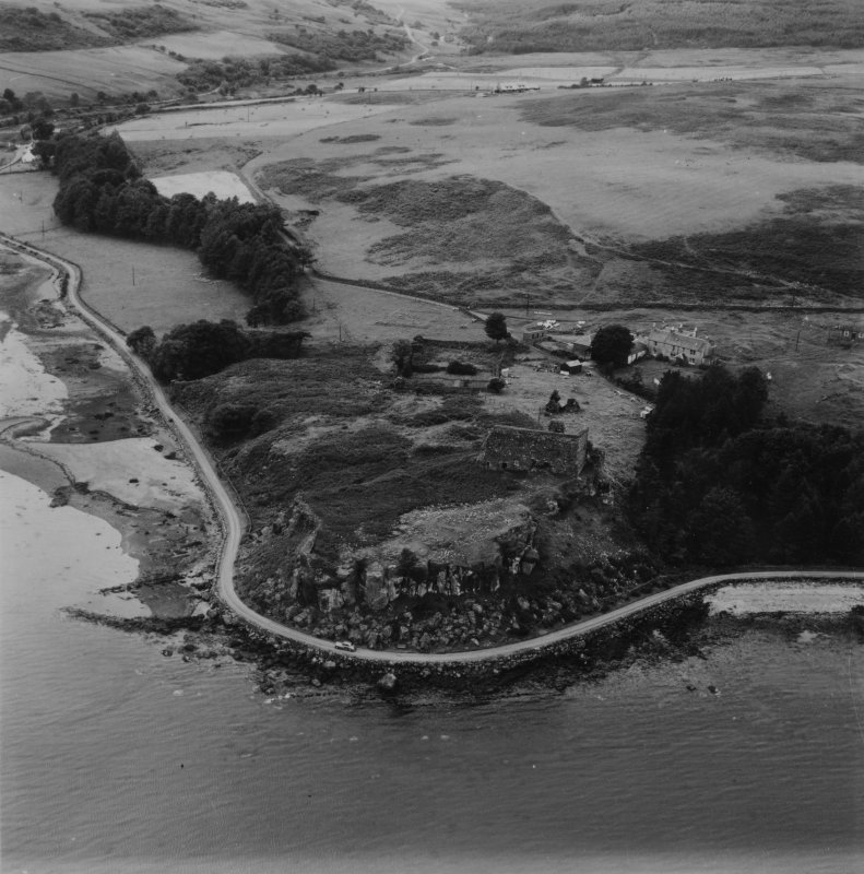 Aros Castle and Aros Mains Farm, Mull.  Oblique aerial photograph taken facing west.  This image has been produced from a print.