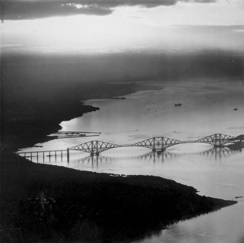 Forth Rail Bridge and Dalmeny Park, Firth of Forth.  Oblique aerial photograph taken facing west.  This image has been produced from a print.