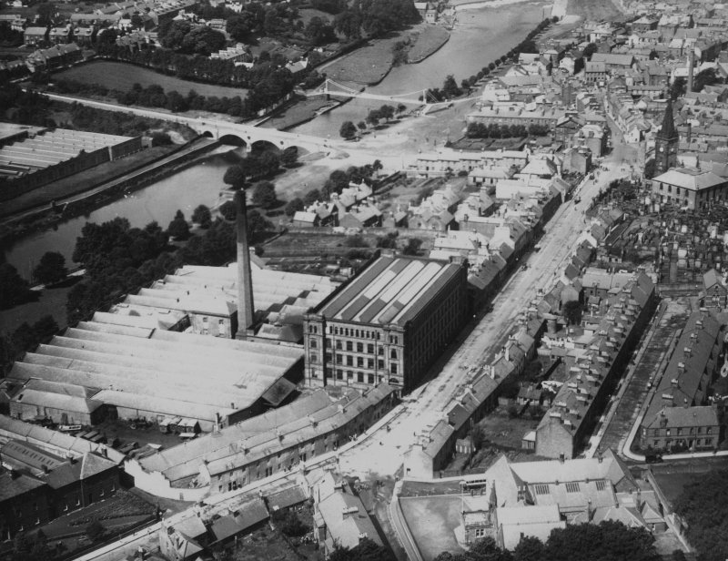 Nithsdale Mills Hosiery Factory, St Michael Street and St Michael's Bridge, Dumfries.  Oblique aerial photograph taken facing west.  This image has been produced from a print.