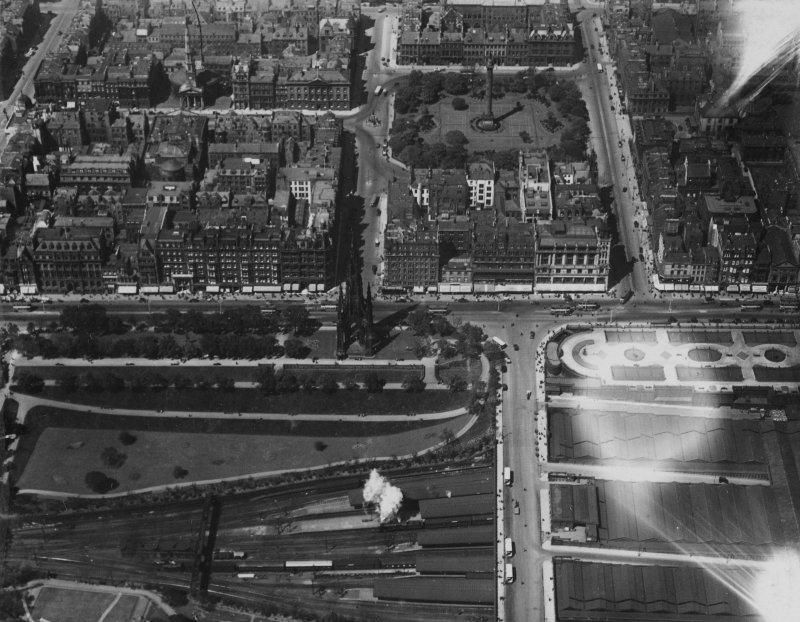 Edinburgh, general view, showing Scott Monument, Princes Street and St Andrew's and St George's Church, George Street.  Oblique aerial photograph taken facing north.  This image has been produced from a print.
