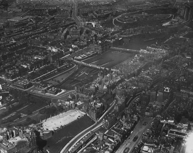 Edinburgh, general view, showing Edinburgh Castle Esplanade and Waverley Station.  Oblique aerial photograph taken facing north-east.  This image has been produced from a print.