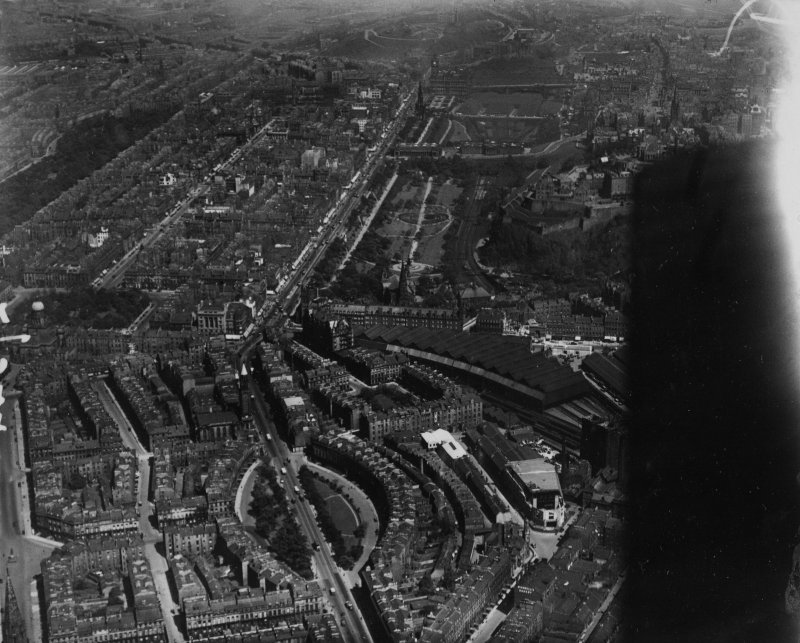 Edinburgh, general view, showing Caledonian Station and Princes Street.  Oblique aerial photograph taken facing east.  This image has been produced from a marked print.