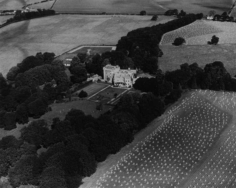Comlongon Castle, Clarencefield.  Oblique aerial photograph taken facing north.  This image has been produced from a print.