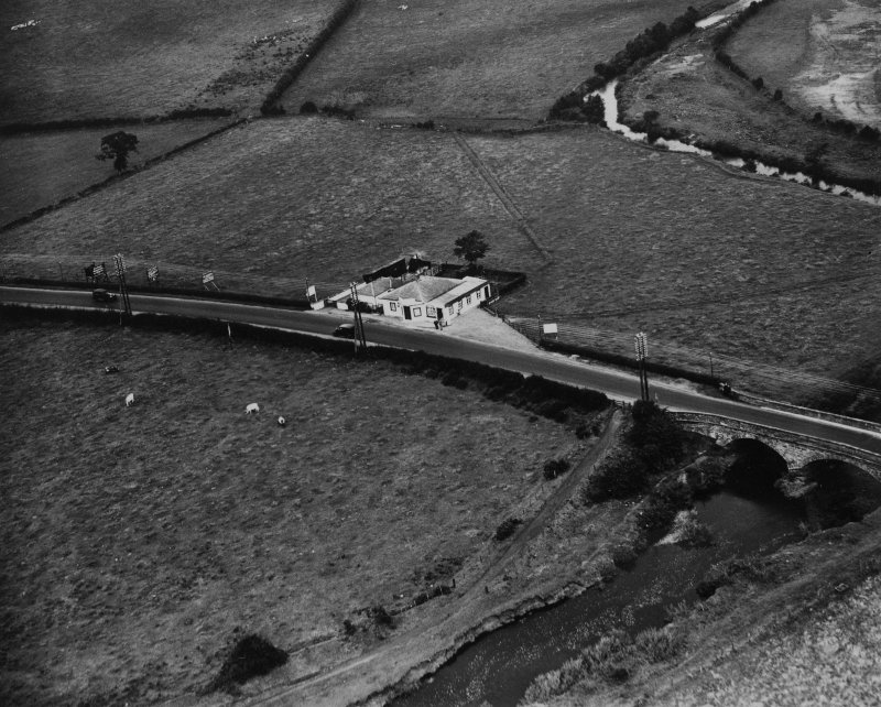 Old Toll Bar, Gretna.  Oblique aerial photograph taken facing north.  This image has been produced from a print.