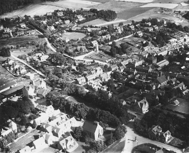 Kingussie, general view, showing High Street and Ardbroilach Road.  Oblique aerial photograph taken facing north-east.  This image has been produced from a print.