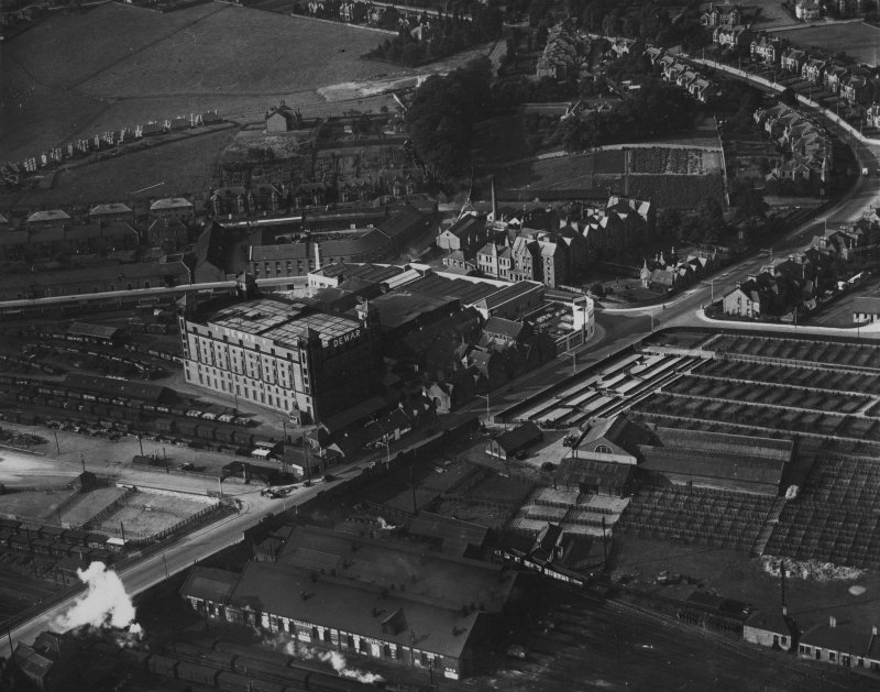 Perth, general view, showing Dewar's Distillery Glover Street Works and Graybank Road.  Oblique aerial photograph taken facing south-west.  This image has been produced from a print.