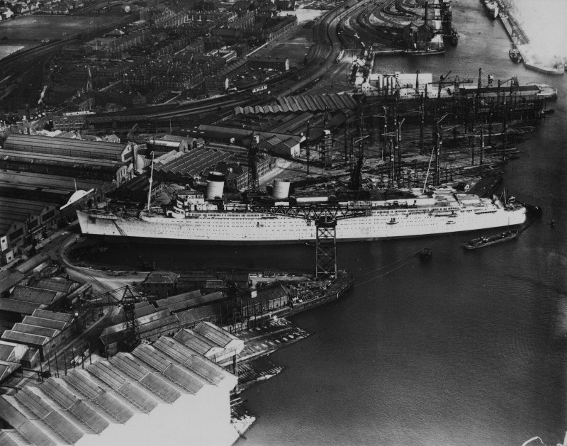 John Brown's Shipyard, Clydebank, Queen Mary under construction.  Oblique aerial photograph taken facing east.  This image has been produced from a print.