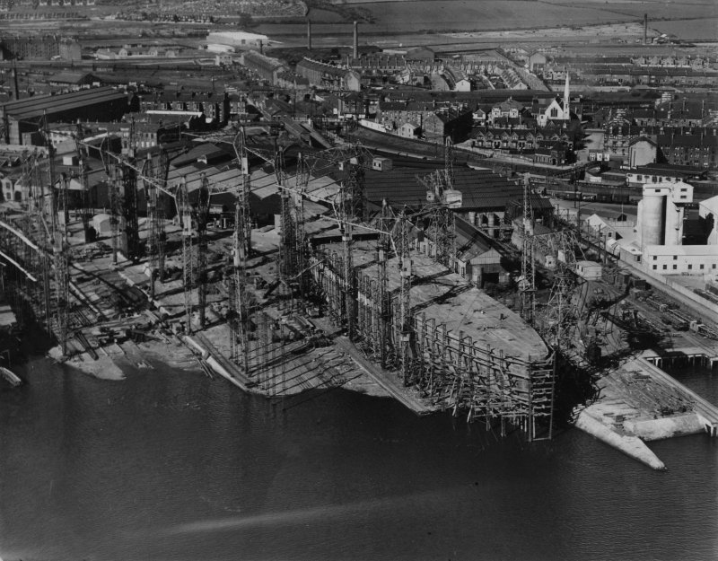 John Brown's Shipyard, Clydebank, ship under construction.  Oblique aerial photograph taken facing north-east.  This image has been produced from a print.