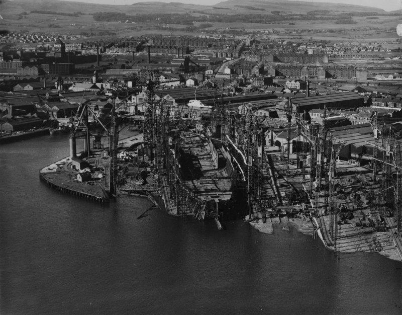 John Brown's Shipyard, Clydebank, Queen Elizabeth under construction.  Oblique aerial photograph taken facing north.  This image has been produced from a print.