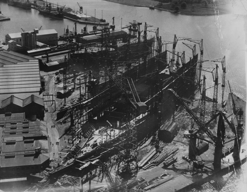 John Brown's Shipyard, Clydebank, Queen Elizabeth under construction.  Oblique aerial photograph taken facing south.  This image has been produced from a damaged print.