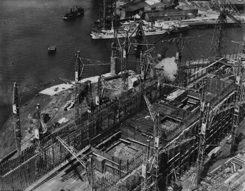 John Brown's Shipyard, Clydebank, Queen Elizabeth under construction.  Oblique aerial photograph taken facing north-west.  This image has been produced from a damaged print.