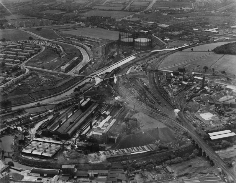 Temple and Dawsholm Gas Works, Maryhill, Glasgow.  Temple Gasholder Nos 4 and 5 are visible (top), Garscube Chemical Works and Dawsholm New Chemical Works are on the right beyond the railway sidings. Oblique aerial photograph taken facing west.  This image has been produced from a print.