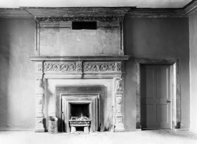 Interior. First floor, hall, fireplace.