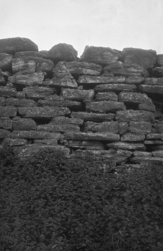 Detail of internal wall face, probably at E end of later rectangular building. Dun an Sticer.