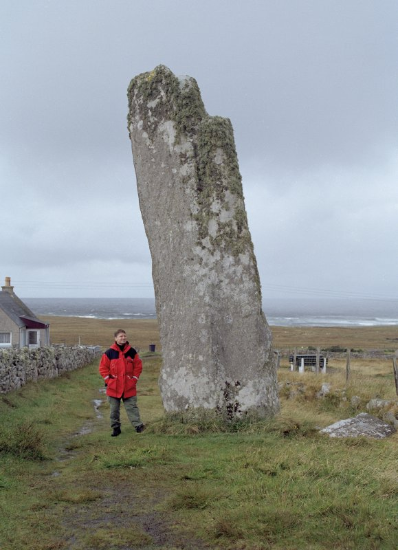 General view of Clach An Trushal Standing Stone, with Dr. Simon Gilmour taken from the south east.
