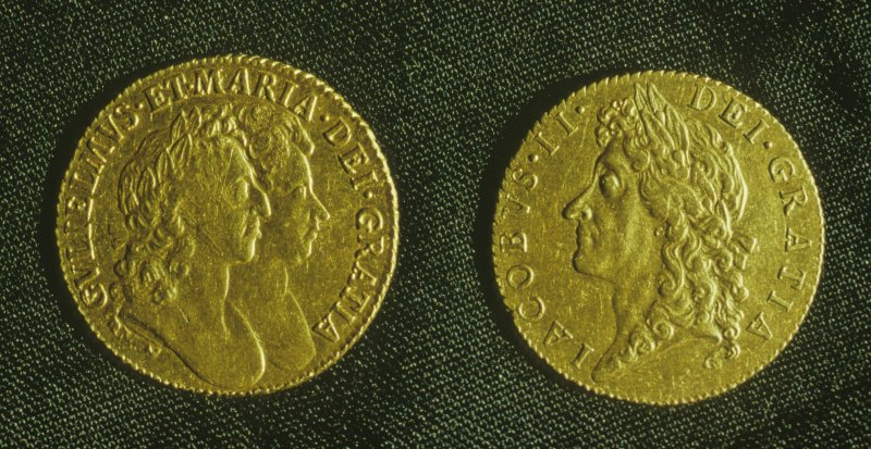 Gold guineas of William and Mary (left) and James II (right), obverse.	 Diameter 25mm.
