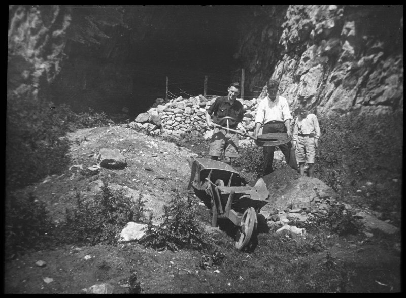 Two men and a boy standing at entrance to cave.  Lantern slide titled: Geo. Applebey, A. McSporran, Geo. McSporran.