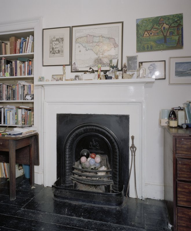 Interior. Detail of ground floor bedroom fireplace