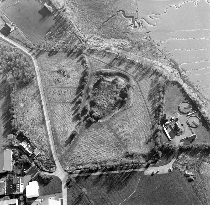 Oblique aerial view centred on the remains of the castle with Castle Mains house adjacent, taken from the NE.